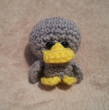 A Lil Grey Ugly - a pocket size duck